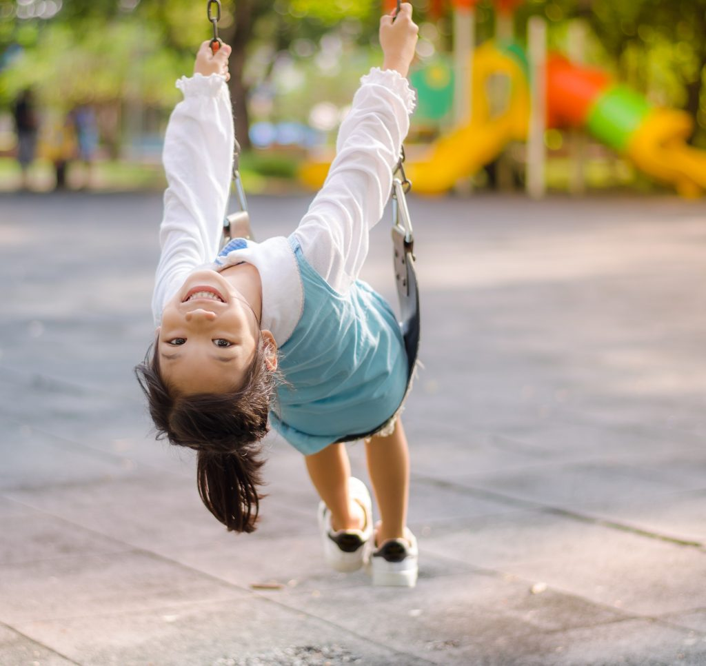 Girl Happily Swinging